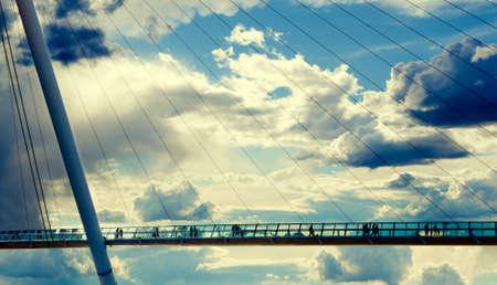 modern bridge against the cloudy sky photo