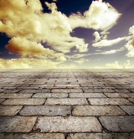 Architectural background with cobbled streets and sky