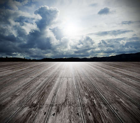 white wood floor: Background of old wood floor and cloudy sky