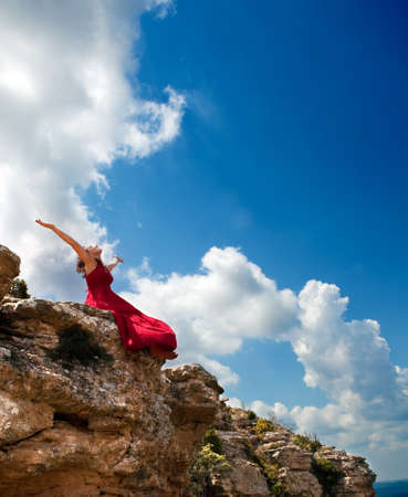 Girl with open arms to the blue sky Stock Photo - 9867056
