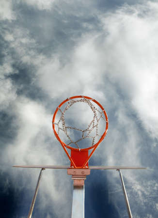 Abstract image of basketball goal against the sky photo