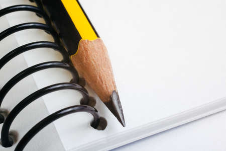 yellow notebook: Pencil detail and copy space Stock Photo