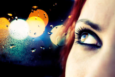 Colorful image detail of girl looking and abstract city lights photo