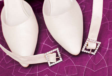 Detail of wedding shoes over purple color photo