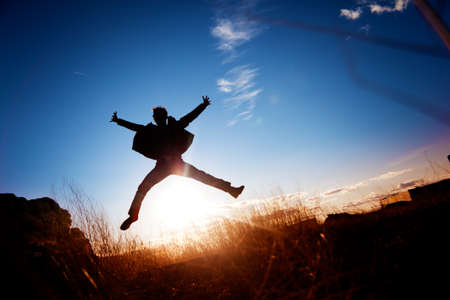 enjoymant: Silhouette of boy jumping  Stock Photo