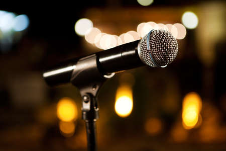 Music background with microphone and Concert lights Archivio Fotografico