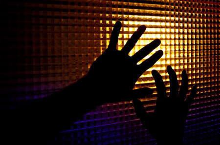 Abstract image of backlit silhouettes of hands photo