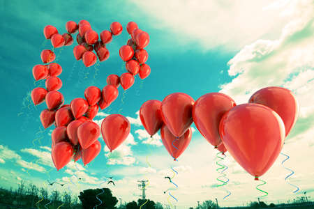 backround: Red balloons forming  a heart shape over the sky