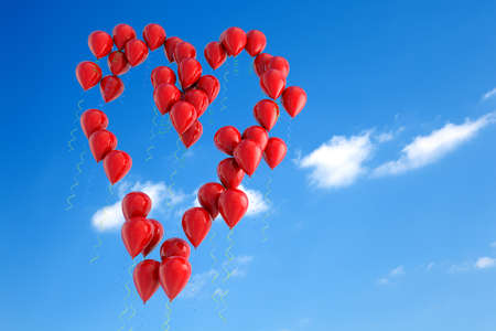 Balloons floating in the sky with heart shape photo