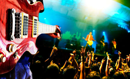 live happy: Music live background,guitar player and public