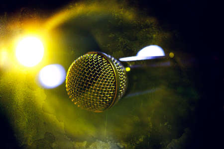 Musical background.Microphone in old style photo