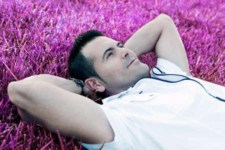 dreamscape: Man portrait lying on the grass Dreamscape Stock Photo
