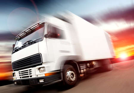 truck speed. Trucks delivering merchandise Banque d'images