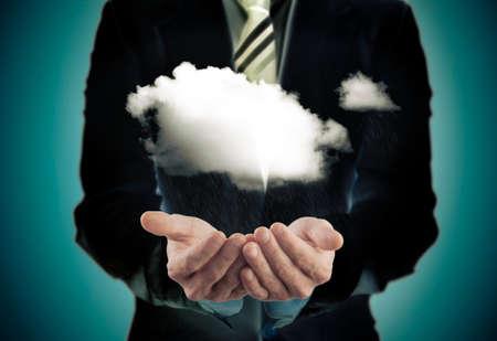 busines: Busines concept.Businessman holding a rainy cloud