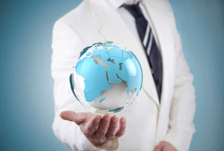 businessman and globe world map. travel and networking concept photo