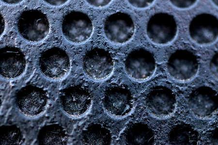 Metal grid surface.Macro image of hole metal grid photo