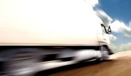 truck speed. Trucks delivering merchandise Archivio Fotografico