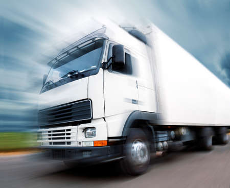 truck speed. Trucks delivering merchandise Stock Photo