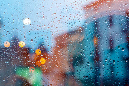 storm in the city through wet window.Home related photo