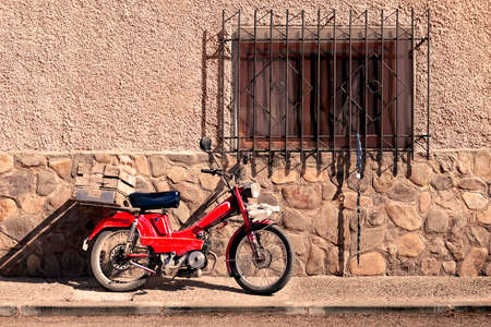 spanish home: Spanish rural village.Motorcycle and home detail at evening Stock Photo