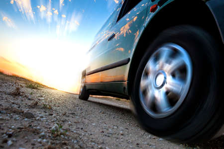 car model: Car and speed. Sunset scenery and fast car outdoor Stock Photo