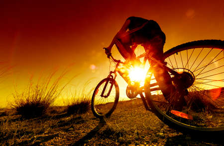 exercise bike: Dreamy sunset and healthy life.Fields and bicycle Stock Photo
