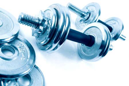 levantar pesas: Pesos u objetos dumbbells.Sport Foto de archivo