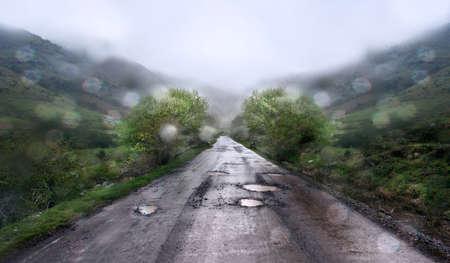 Rainy day and mountain road. photo
