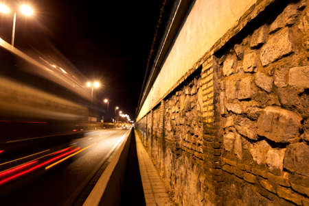 cobble: City street at night.Wall cobble and road Stock Photo