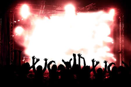rock: Live music background. Silhouettes of public and concert