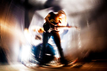 drummer: Man playing the guitar.Abstract Live music background concept.Guitar player and rock music concept