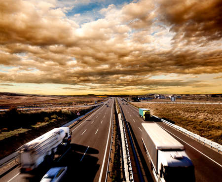 cargo: International shipment, trucks and cars driving on the highway. Logistics and warehousing