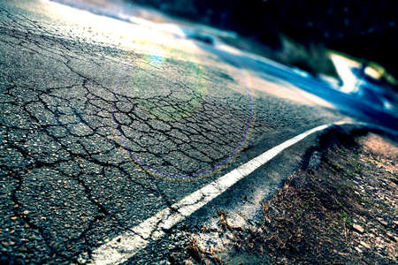 road surface: Travel concept. Cracked asphalt and curve road.Road lines Stock Photo