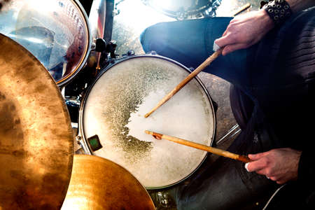 Man playing the drum.Live music background concept.Drummer and rock music