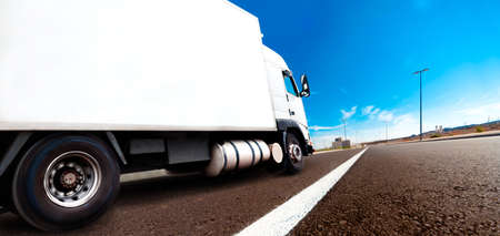 Truck and transport. Lorry delivering freight by road or highway Stock Photo