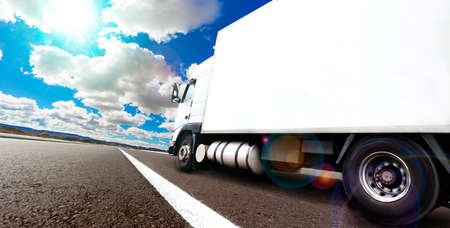moving truck: Truck and transport. Lorry delivering freight by road or highway Stock Photo