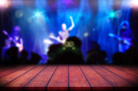 Abstract blurred background.Wooden table or counter and music band on stage Archivio Fotografico