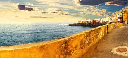 Sunset scenery Spain sea and island .Beach adventures and travel concept.Puerto de la cruz.Scenic landscape.Canary island Seascape.Tenerife village.