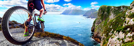 Exercise and healthy lifestyle. Biker and scenic cliff landscape.Recreation and leisure in outdoor.Extreme sport and adventures.Mtb bike concept