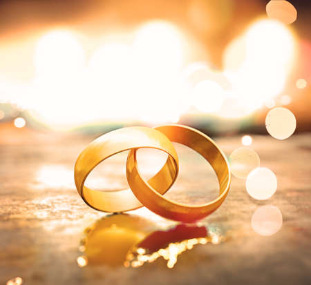 Romantic background of  jewelry and marriage.Still life of gold wedding rings.3d illustration