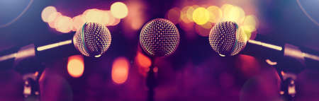 Live music and conference background.Karaoke and entertainment concept.Microphone and stage lights.Concert and music concept Stock fotó