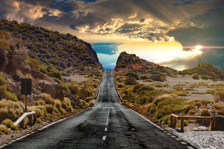 Road through the scenic landscape to the destination in Tenerife natural park.