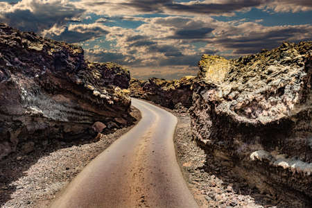 Road through the scenic landscape to the destination in Timanfaya natural park in Lanzarote,Canary island,Spain 版權商用圖片
