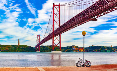 Panoramic photograph of the 25 de Abril bridge in the city of Lisbon over the Tajo River