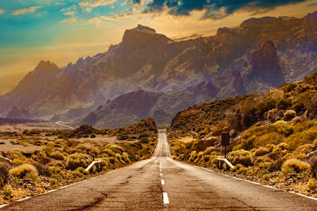 Road through the scenic landscape to the destination in Tenerife natural park. Stock Photo