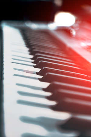 Electric piano keys and music production concept