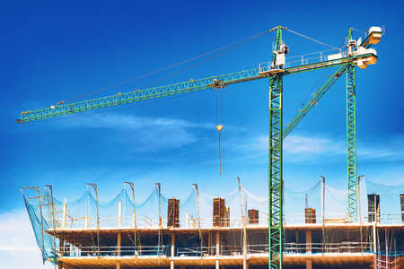 Construction and real estate industry. Sunset and foundation structure of houses.