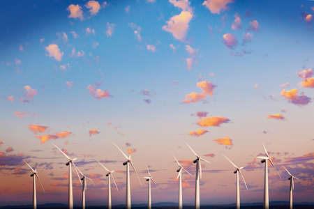 Wind mills farm and sunset landscape. Archivio Fotografico