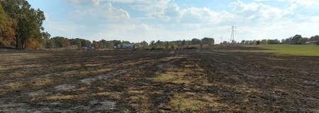 scorched, burned, earth, field, hay, charred, trees, barn, sad, loss Stock Photo