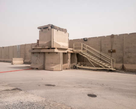 Guard tower constructed of cement barriers Stock Photo